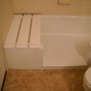 Notch cut tub to shower conversion in cast iron bathtub