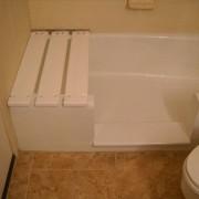 Notch cut tub to shower conversion in cast iron bathtub