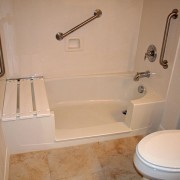 Notch cut tub to shower conversion in cultured marble bathtub