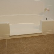Notch cut tub to shower conversion in fiberglass