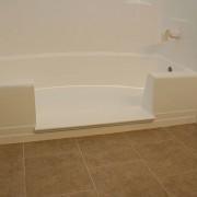 Notch cut tub to shower conversion in fiberglass