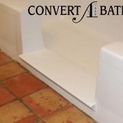 Notch cut tub to shower conversion in steel tub
