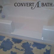 Notch cut tub to shower conversion in existing bathtub